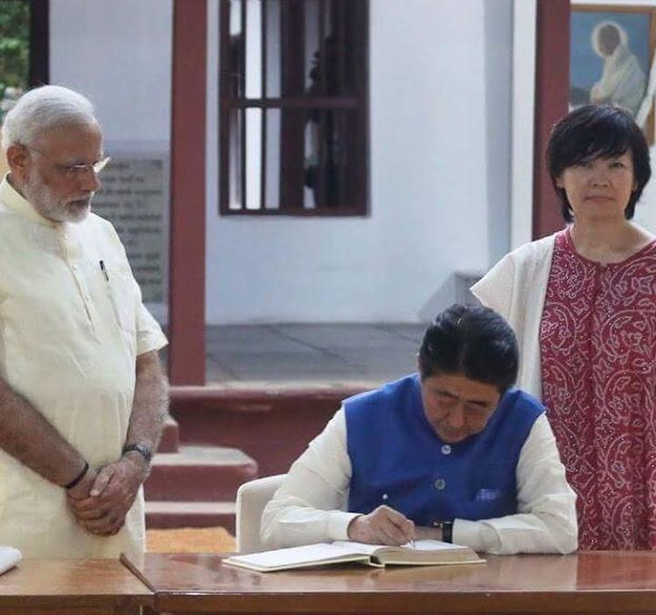 Japanese PM Shinzo Abe signs the visitors book with his wife Akie Abe and Indian Prime Minister Narendra Modi standing beside him at Sabarmati Ashram in Ahmedabad.  #NarendraModi #PMModi #PMNarendraModi #IndianPrimeMinister #PrimeMinisterOfIndia #JapanesePrimeMinister #JapanesePM #ShinzoAbe #PMSinzoAbe #Japan #India #News #InternationalNews