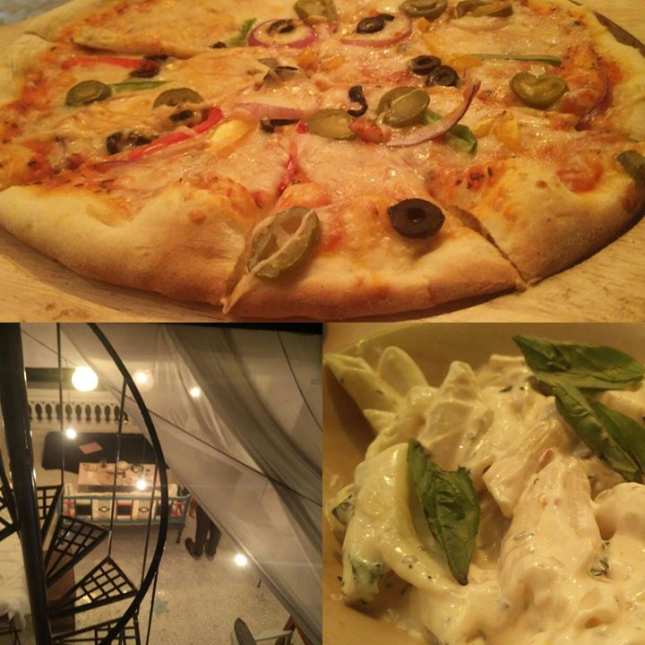 Wood fired pizzas on the Rooftop...ahaan New Place in town. The Wayfarers pizzeria.. Worth a visit for pizza lovers... ! And people who prefer less crowded quality hangouts. Raw and Real Ambience for a complete chill out. Address - Sunrise park road. Gurukul.