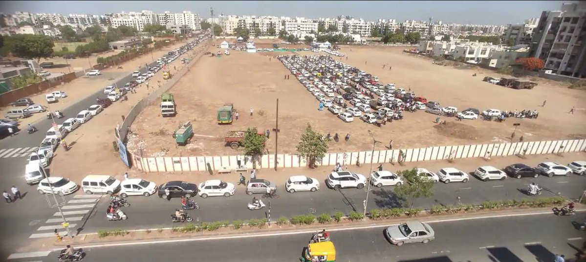 RT @AmitHPanchal: People line up for #Vaccination at AMC Ground in Nikol!💉  Image: @Zee24Kalak #Ahmedabad #COVID19 https://t.co/LP0b0maEAr